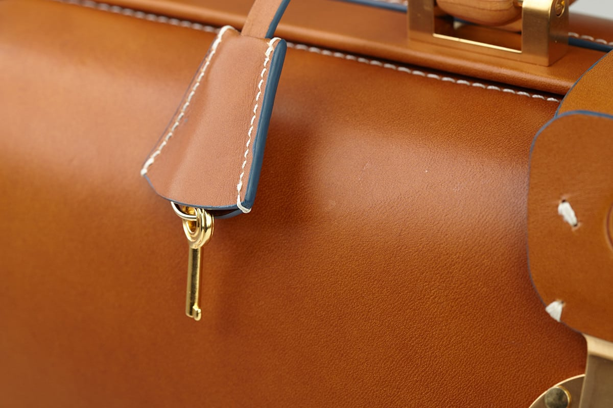 Signature Briefcase Backpack with wooden handle key for the lock